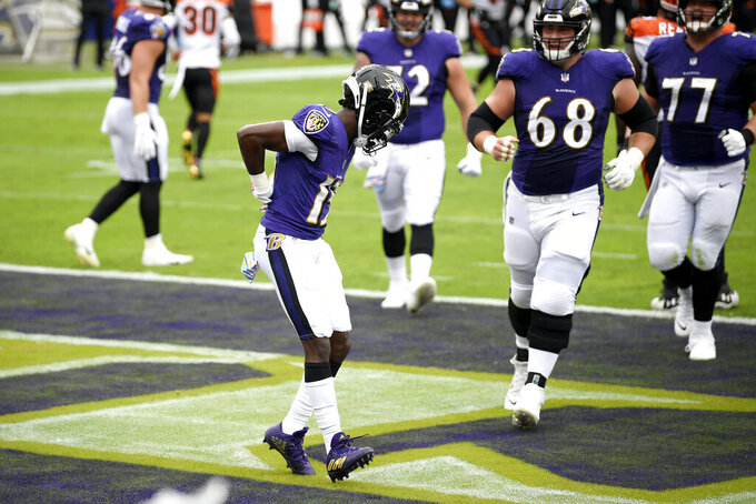 Baltimore Ravens wide receiver Marquise Brown, left, celebrates after catching a touchdown pass against the Cincinnati Bengals during the first half of an NFL football game, Sunday, Oct. 11, 2020, in Baltimore. (AP Photo/Nick Wass)
