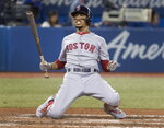 Boston Red Sox's Mookie Betts drops to his knees after being backed off the plate by an inside pitch from the Toronto Blue Jays during the seventh inning of a baseball game Tuesday, Sept. 10, 2019, in Toronto. (Fred Thornhill/The Canadian Press via AP)