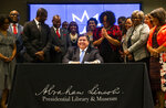Illinois Gov. JB Pritzker signs the bill making Juneteenth an official state holiday in Illinois during a ceremony at the Abraham Lincoln Presidential Library, Wednesday, June 16, 2021, in Springfield, Ill. (Justin L. Fowler/The State Journal-Register via AP)