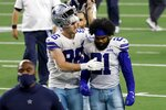 Dallas Cowboys tight end Dalton Schultz (86) and running back Ezekiel Elliott (21) walk off the field after their 37-34 win against the New York Giants in an NFL football game in Arlington, Texas, Sunday, Oct. 11, 2020. (AP Photo/Ron Jenkins)