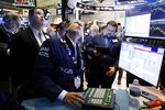 FILE - In this Jan. 15, 2020, file photo specialist Glenn Carell, center, works with traders at the post that handles NIO, a Chinese automobile manufacturer, on the floor of the New York Stock Exchange. The U.S. stock market opens at 9:30 a.m. EST on Tuesday, Jan. 21. (AP Photo/Richard Drew, File)