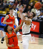 Colorado forward Lucas Siewert, right, mishandles a pass as Oregon State guard Stephen Thompson Jr. defends in the second half of an NCAA college basketball game Thursday, Jan. 31, 2019, in Boulder, Colo. (AP Photo/David Zalubowski)