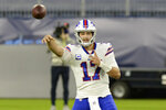 Buffalo Bills quarterback Josh Allen (17) passes against the Tennessee Titans in the first half of an NFL football game Tuesday, Oct. 13, 2020, in Nashville, Tenn. (AP Photo/Mark Zaleski)