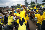 Supporters of Ugandan President Yoweri Kaguta Museveni celebrate in Kampala, Uganda, Saturday Jan. 16, 2021, after their candidate was declared winner of the presidential elections. Uganda's electoral commission says longtime President Yoweri Museveni has won a sixth term, while top opposition challenger Bobi Wine alleges rigging and officials struggle to explain how polling results were compiled amid an internet blackout. In a generational clash widely watched across the African continent, the young singer-turned-lawmaker Wine posed arguably the greatest challenge yet to Museveni. (AP Photo/Jerome Delay)