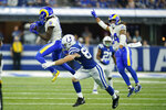 Los Angeles Rams' Jalen Ramsey (5) intercepts a pass intended for Indianapolis Colts' Jack Doyle (84) during the second half of an NFL football game, Sunday, Sept. 19, 2021, in Indianapolis. (AP Photo/Michael Conroy)