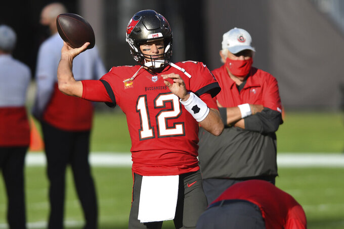 Tampa Bay Buccaneers quarterback Tom Brady (12) throws a pass before an NFL football game against the Kansas City Chiefs Sunday, Nov. 29, 2020, in Tampa, Fla. (AP Photo/Jason Behnken)