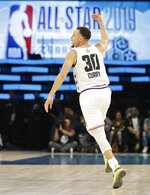 CORRECTS TO THE WARRIORS, NOT THE BUCKS - Team Giannis' Stephen Curry, of the Golden State Warriors, celebrates a basket against Team LeBron during the first half of an NBA All-Star basketball game, Sunday, Feb. 17, 2019, in Charlotte, N.C. (AP Photo/Chuck Burton)