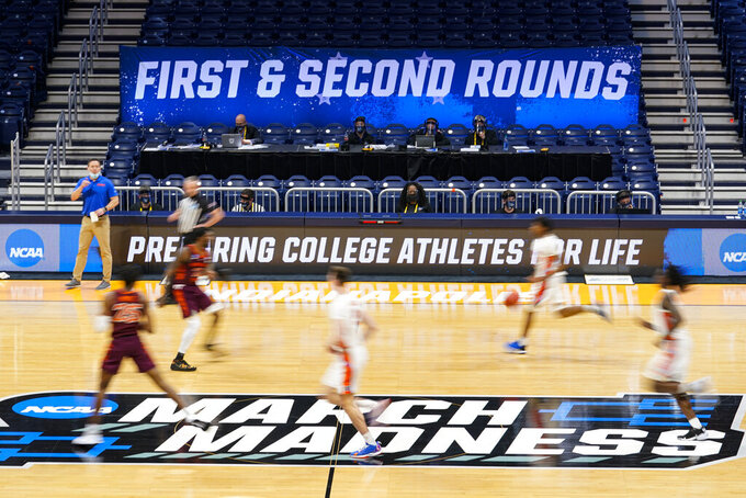 Florida plays against Virginia Tech in the second half of a first round game in the NCAA men's college basketball tournament at Hinkle Fieldhouse in Indianapolis, Friday, March 19, 2021. (AP Photo/Michael Conroy)