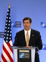 U.S. Secretary of Defense Mark Esper speaks during a joint press conference with NATO Secretary General Jens Stoltenberg at NATO headquarters in Brussels, Friday, June 26, 2020. U.S. Secretary of Defense Mark Esper is at NATO to follow-up on a broad range of issues raised during last week's NATO defense ministerial. (AP Photo/Virginia Mayo, Pool)