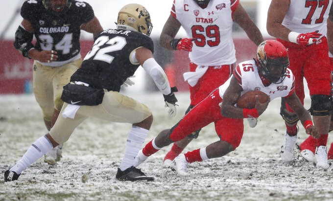 Utah quarterback Jason Shelley, right, runs for a first down as Colorado linebacker Rick Gamboa defends in the first half of an NCAA college football game Saturday, Nov. 17, 2018, in Boulder, Colo. (AP Photo/David Zalubowski)