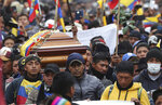 Anti-government protesters carry the coffin that contain the remains of indigenous leader Inocencio Tucumbi, who protesters say died during the country's recent unrest, in a procession leading into the Casa de Cultura in Quito, Ecuador, Thursday, Oct. 10, 2019. The government's removal of fuel subsidies last week plunged Ecuador into upheaval, triggering protests, looting, vandalism, clashes with security forces, the blocking of highways and the suspension of parts of its vital oil industry. (AP Photo/Dolores Ochoa)