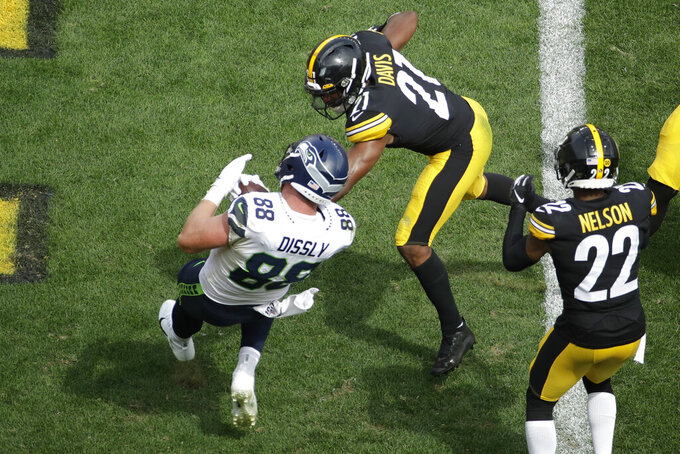 Seattle Seahawks tight end Will Dissly (88) makes a touchdown catch past Pittsburgh Steelers free safety Sean Davis (21) and cornerback Steven Nelson (22) in the second half of an NFL football game, Sunday, Sept. 15, 2019, in Pittsburgh. (AP Photo/Gene J. Puskar)