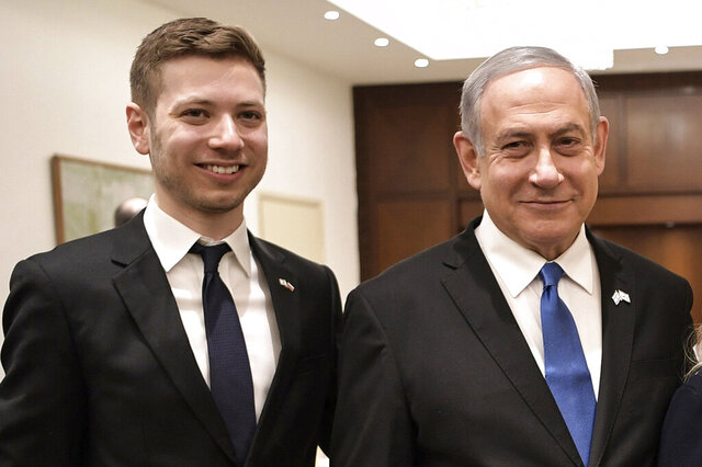 FILE - In this Jan. 23, 2020, file photo, Israeli Prime Minister Benjamin Netanyahu, second from left, and son Yair, left, pose for a photo in Tel Aviv, Israel, ahead of the World Holocaust Forum. As the scandal-plagued prime minister stands trial for corruption, his 28-year-old son has emerged as a driving force in a counterattack against critics and the state institutions prosecuting the longtime Israeli leader. A favorite of the prime minister's nationalistic base and far right leaders around the world, Yair Netanyahu has become a fixture in the news. (Aleksey Nikolskyi/Sputnik Kremlin Pool Photo via AP, File)
