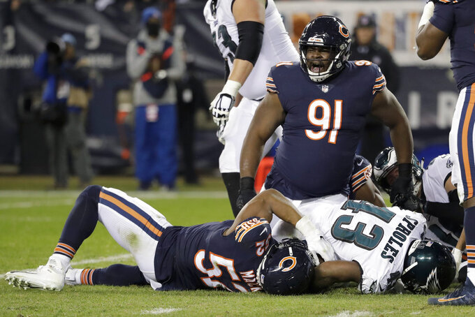 Chicago Bears nose tackle Eddie Goldman (91) reacts as Chicago Bears linebacker Khalil Mack (52) stops Philadelphia Eagles running back Darren Sproles (43) during the second half of an NFL wild-card playoff football game Sunday, Jan. 6, 2019, in Chicago. (AP Photo/Nam Y. Huh)