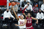 Rutgers' Ron Harper Jr. (24) puts up a shot against Indiana's Trayce Jackson-Davis (23) during the second half of an NCAA college basketball game at the Big Ten Conference tournament, Thursday, March 11, 2021, in Indianapolis. (AP Photo/Darron Cummings)