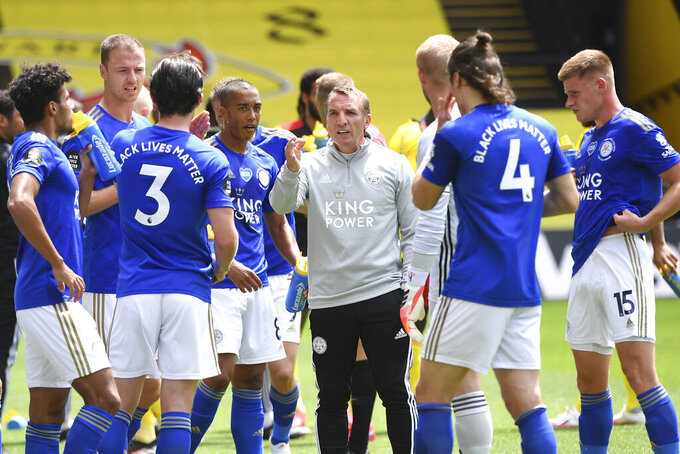 Leicester's manager Brendan Rodgers talks to the team during the English Premier League soccer match between Watford and Leicester CITY at the Vicarage Road Stadium in Watford, England, Saturday, June 20, 2020. (Michael Regan/Pool via AP)