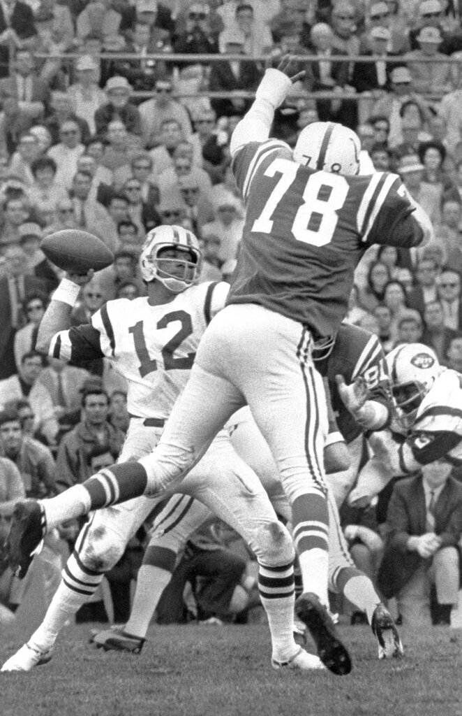 FILE - In this Jan. 12, 1969, file photo, New York Jets quarterback Joe Namath (12) throws the ball against the Baltimore Colts in Super Bowl III in Miami. Just over 50 years ago, halfway through the history of the NFL, the New York Jets completed one of the most unexpected championship seasons in the history of the sport when a brash quarterback named Joe Namath helped engineer a Super Bowl victory over the heavily favored Baltimore Colts. That now-famous journey by Broadway Joe and the boys through the AFL that ended in triumph in Miami took a lesser-known detour for the second week of the schedule. Yes, for one weekend, the Jets actually landed in Birmingham, Alabama, at Legion Field.(AP Photo/File)