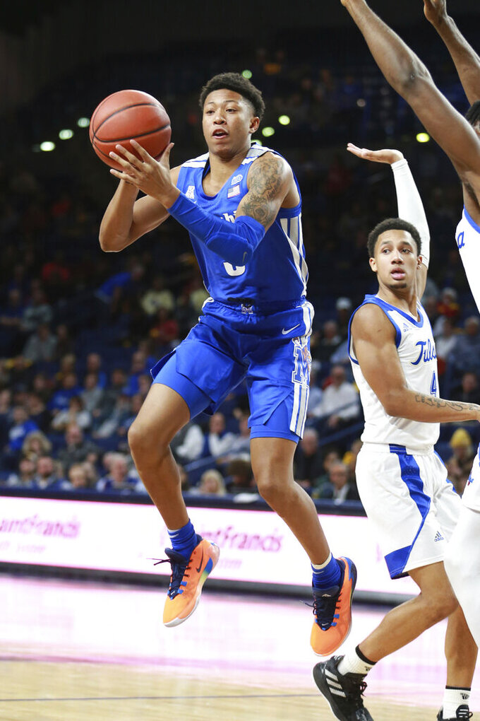 Memphis guard Boogie Ellis (5) passes in the first half of an NCAA college basketball game against Tulsa in Tulsa, Okla., Wednesday, Jan. 22, 2020. (AP Photo/Joey Johnson)