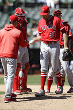 Los Angeles Angels' Ty Buttrey (31) hands the ball to manager Brad Ausmus as he is relieved in the seventh inning of a baseball game against the Oakland Athletics, Thursday, Sept. 5, 2019, in Oakland, Calif. (AP Photo/Ben Margot)