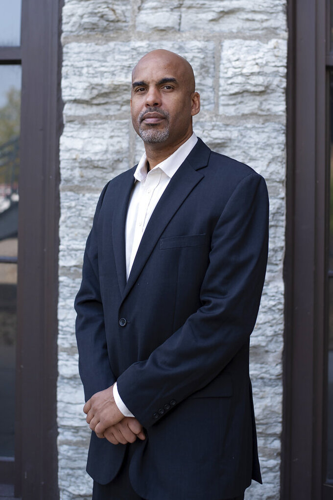 """In this undated photo provided by the John D. & Catherine T. MacArthur Foundation, Damien Fair poses for a photo in Minneapolis. Fair, a cognitive neuroscientist, is among the 21 recipients of this year's """"genius grants."""" The John D. and Catherine T. MacArthur Foundation announced the fellowships Tuesday Oct. 6, 2020. Each will receive $625,000 over five years to spend as they please.  (John D. & Catherine T. MacArthur Foundation via AP)"""