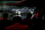 The Ferrari Roma car is unveiled in Rome, Thursday, Nov. 14, 2019. Ferrari unveils a new sports coupe aimed at enticing entry-level buyers and competing with the Porsche 911, part of a complete refresh of its model lineup by 2022. (Fabio Frustaci/ANSA via AP)