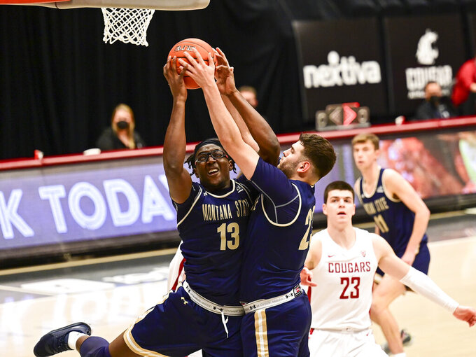 Montana State forward Jubrile Belo (13) and forward Borja Fernandez (23) fight over a defensive rebound in the first half of an NCAA college basketball game, Friday, Dec. 18, 2020, in Pullman, Wash. (Pete Caster/Lewiston Tribune via AP)