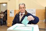 Italian former Premier Romano Prodi casts his ballot for Emilia Romagna region elections, at a polling station in Bologna, Italy, Sunday, Jan. 26, 2020. Right-wing opposition leader Matteo Salvini is telling Italians who are voting in two regions to use their ballots to help his anti-migrant party return to national power.  Voting began on Sunday morning in Emilia-Romagna, a northern region where the left-wing has held power for decades, and in Calabria, in the south, an area Salvini's League party once disparaged as unproductive but where it now wants to expand a foothold. (Massimo Paolone/Lapresse via AP)