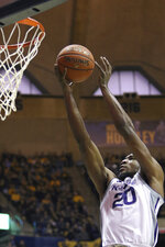 Kansas State forward Xavier Sneed (20) goes up for a  shot against West Virginia during the first half of an NCAA college basketball game Saturday, Feb. 1, 2020, in Morgantown, W.Va. (AP Photo/Kathleen Batten)