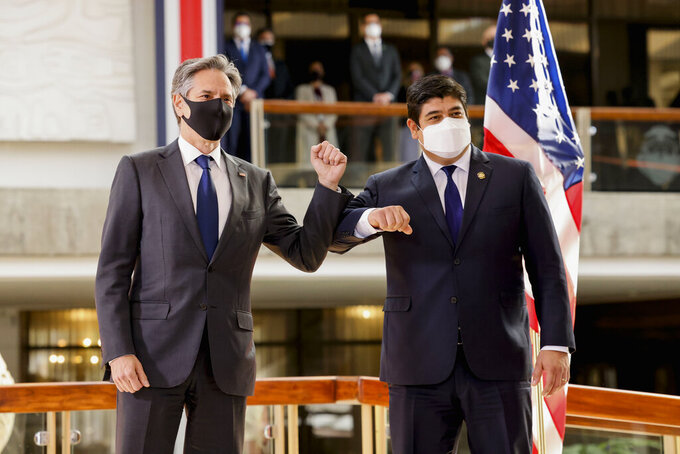 U.S. Secretary of State Antony Blinken and Costa Rica's President Carlos Alvarado elbow bump after a news conference Tuesday, June 1, 2021, in San Jose, Costa Rica.  (Evelyn Hockstein/Pool via AP)