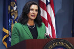 FILE - In this Friday, Aug. 14, 2020, file photo provided by the Michigan Office of the Governor, Gov. Gretchen Whitmer addresses the state during a speech in Lansing, Mich. A man charged in an alleged conspiracy to kidnap Whitmer also made threatening online comments about President Donald Trump, former presidents Barack Obama and Bill Clinton and other prominent political figures, an FBI agent said in a federal court filing, of which a copy was obtained by The Associated Press, Wednesday, Oct. 28, 2020. (Michigan Office of the Governor via AP, File)