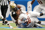 Colorado quarterback Brendon Lewis (12) is sacked by Texas defensive lineman Jacoby Jones (36) during the first half of the Alamo Bowl NCAA college football game Tuesday, Dec. 29, 2020, in San Antonio. (AP Photo/Eric Gay)