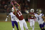 Stanford's Simi Fehoko, left, makes a pass reception past Washington's Elijah Molden (3) in the first half of an NCAA college football game Saturday, Oct. 5, 2019, in Stanford, Calif. (AP Photo/Ben Margot)
