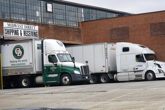 Trucks rest in a shipping bay at Midwest Direct, Tuesday, Oct. 20, 2020, in Cleveland. The printing and mailing of 2.4 million delayed ballots across Ohio and Pennsylvania are all caught up, the vendor responsible for the backlog announced Tuesday. Cleveland-based Midwest Direct said in a statement that extra staff expanded hours and added equipment was required to meet the