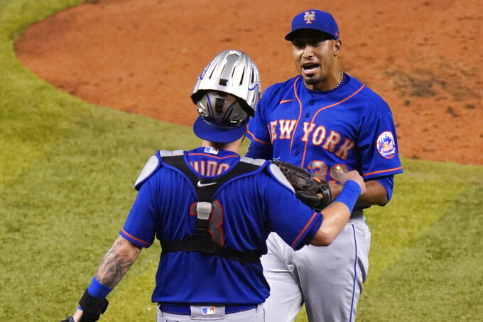 New York Mets catcher Tomás Nido (3) and relief pitcher Edwin Diaz celebrate after defeating the Miami Marlins 8-3 during a baseball game, Tuesday, Aug. 18, 2020, in Miami. (AP Photo/Lynne Sladky)