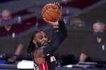 Miami Heat's Jae Crowder attempts a shot during the first half of an NBA conference final playoff basketball game against the Boston Celtics on Saturday, Sept. 19, 2020, in Lake Buena Vista, Fla. (AP Photo/Mark J. Terrill)