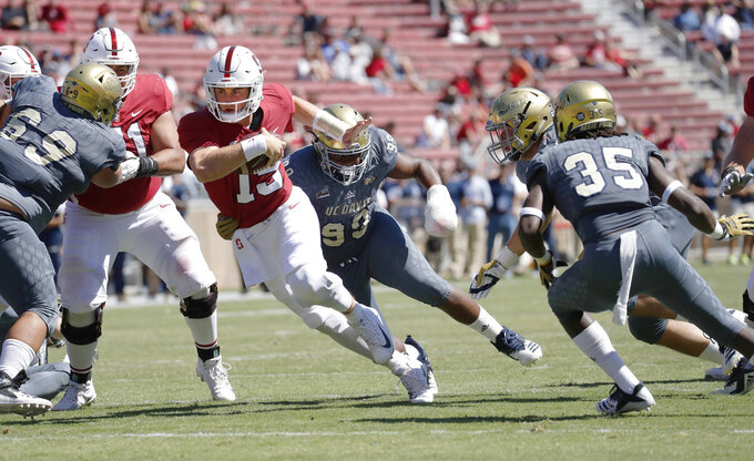 Stanford quarterback Davis Mills (15) runs a keeper against UC Davis in the second half in an NCAA college football game in Stanford, Calif., Saturday, Sept. 15, 2018. (AP Photo/Jim Gensheimer)