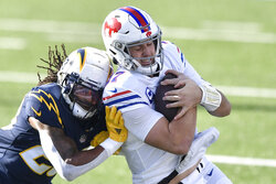 Buffalo Bills quarterback Josh Allen, right, is pushed out of a bounds by Los Angeles Chargers strong safety Rayshawn Jenkins, left, during the first half of an NFL football game, Sunday, Nov. 29, 2020, in Orchard Park, N.Y. (AP Photo/Adrian Kraus)