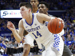 Kentucky's Tyler Herro (14) drives near Mississippi State's Nick Weatherspoon during the first half of an NCAA college basketball game against in Lexington, Ky., Tuesday, Jan. 22, 2019. (AP Photo/James Crisp)