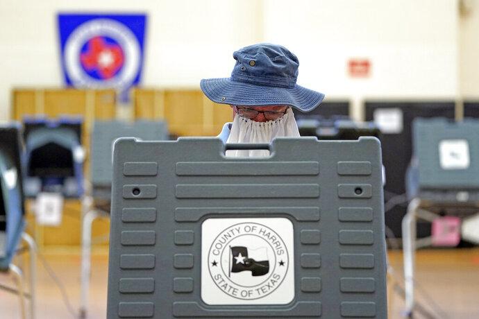 Peter McDonald casts his ballot, Tuesday, July 14, 2020, in Houston. (AP Photo/David J. Phillip)