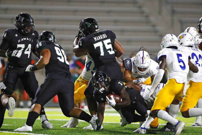 Hawaii running back Dedrick Parson (31) tries to gain yards in the first half of an NCAA college football game against San Jose State, Saturday, Sept. 18, 2021, in Honolulu. (AP Photo/Marco Garcia)(