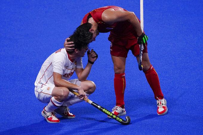 Belgium's Arthur Van Doren, comforts Spain's Josep Romeu Argemi after Belgium won their men's field hockey match at the 2020 Summer Olympics, Sunday, Aug. 1, 2021, in Tokyo, Japan. (AP Photo/John Locher)