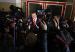 Presidential candidate and European Commission Vice-President Maros Sefcovic answers questions to media after casting his vote at a polling station during the first round of the presidential election in Bratislava, Slovakia, Saturday, March 16, 2019. (AP Photo/Petr David Josek)
