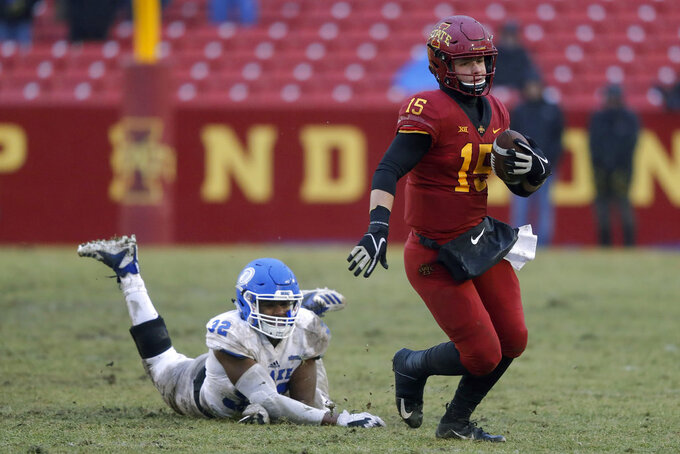 Iowa State quarterback Brock Purdy runs from Drake defensive back Cooper Christiano, left, during the first half of an NCAA college football game, Saturday, Dec. 1, 2018, in Ames, Iowa. (AP Photo/Charlie Neibergall)