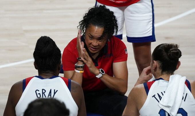 United States' head coach Dawn Staley, center, talks to the players during women's basketball gold medal game against Japan at the 2020 Summer Olympics, Sunday, Aug. 8, 2021, in Saitama, Japan. (AP Photo/Luca Bruno)