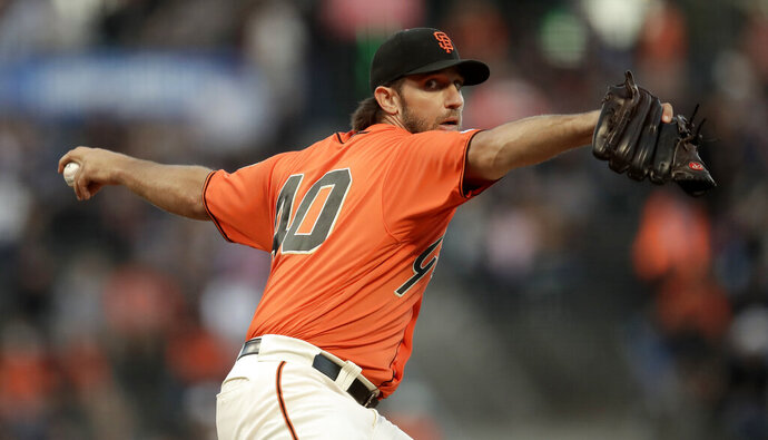 San Francisco Giants pitcher Madison Bumgarner works against the San Diego Padres during the first inning of a baseball game Friday, Aug. 30, 2019, in San Francisco. (AP Photo/Ben Margot)