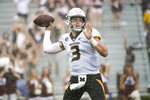 Missouri quarterback Drew Lock (3) attempts a pass against South Carolina during the second half of an NCAA college football game Saturday, Oct. 6, 2018, in Columbia, S.C. (AP Photo/Sean Rayford)