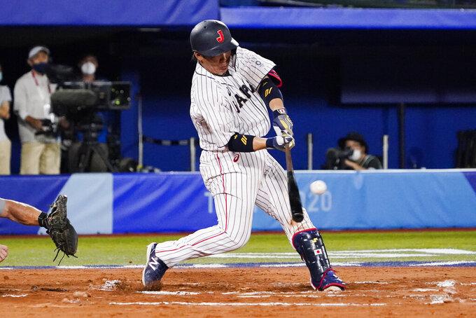 Japan's Takuya Kai hits during the tenth inning of a baseball game against the United States at the 2020 Summer Olympics, Monday, Aug. 2, 2021, in Yokohama, Japan. Japan won 7-6. (AP Photo/Sue Ogrocki)