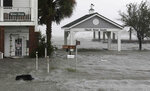 High winds and water surround buildings as Hurricane Florence hits Front Street in downtown Swansboro N.C., Friday, Sept. 14, 2018. (AP Photo/Tom Copeland)