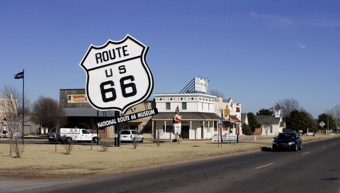 FILE - In this Jan. 31, 2006 file photo, the Route 66 Museum still dwarfs the landscape in Elk City, Okla. Republican Sen. Nathan Dahm said Wednesday, Nov. 6, 2019 that he is done trying to rename a portion of the iconic Route 66 highway in northeastern Oklahoma after President Donald Trump. (AP Photo, File)