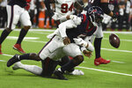 Houston Texans quarterback Tyrod Taylor (5) fumbles the ball as he is hit by Tampa Bay Buccaneers' Joe Tryon-Shoyinka during the first half of an NFL preseason football game Saturday, Aug. 28, 2021, in Houston. The Buccaneers recovered the fumble. (AP Photo/Eric Christian Smith)